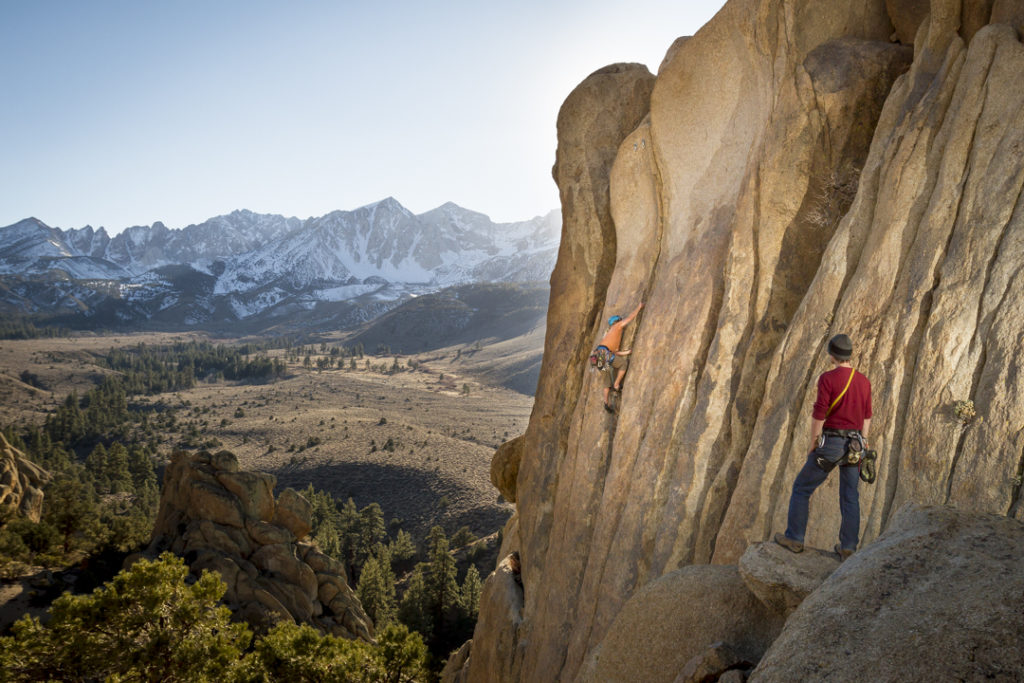 Rock climber Aaron Livingston (@livingstonaaron) puts up a new route in the hills above the Buttermilks as photographer Dana Felthauser (@danafelthauser) watches and shoots photos. (Out of Reach 5.11-)